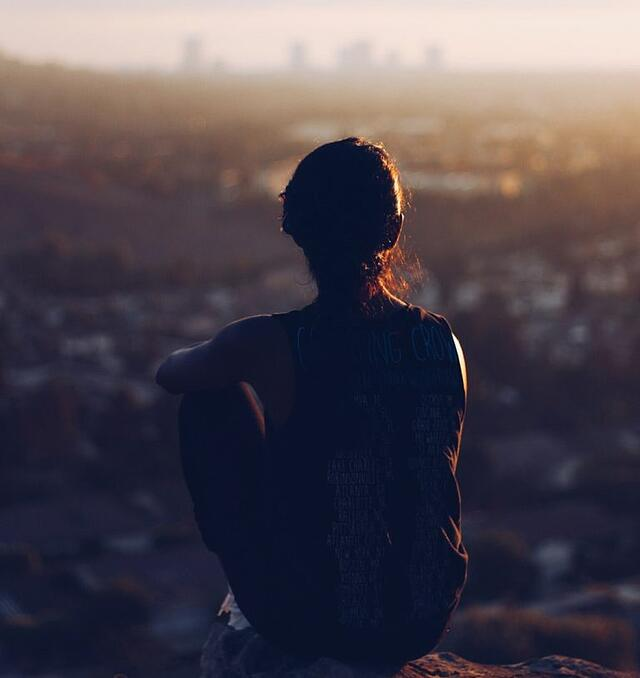 if mindfulness is good for us woman looks over city.jpg