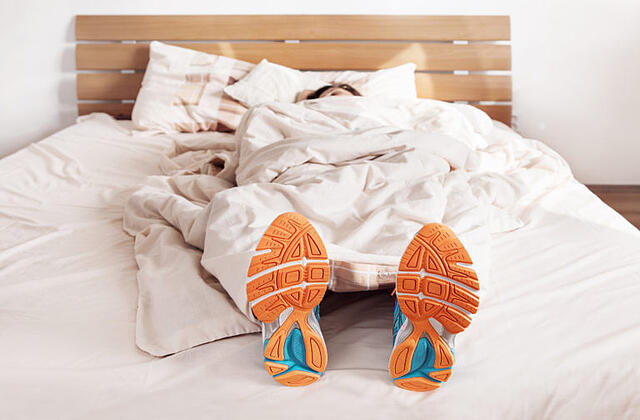 running out of time to exercise running shoes in bed.jpg